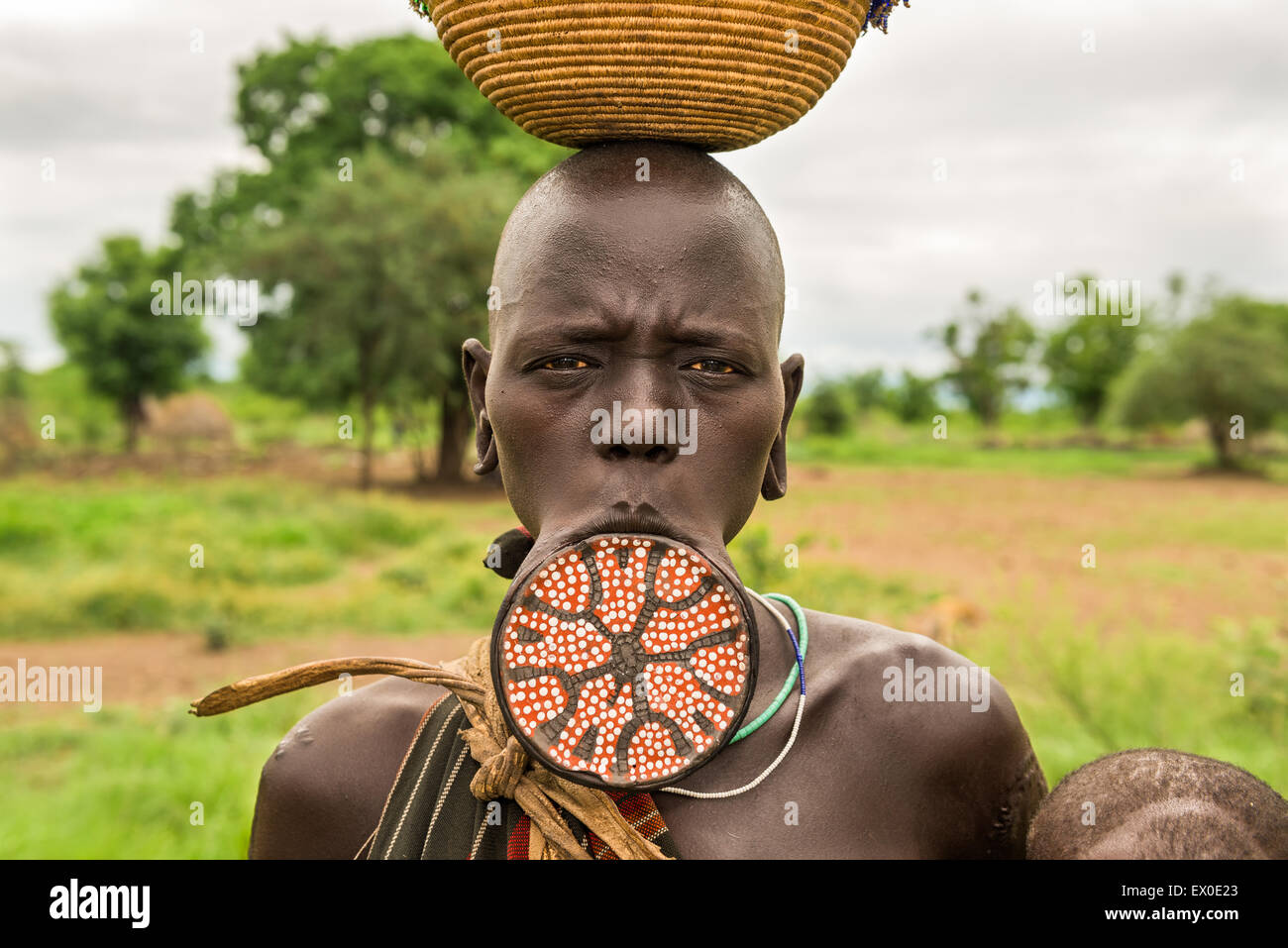 woman from the african tribe mursi with a big lip plate stock photo