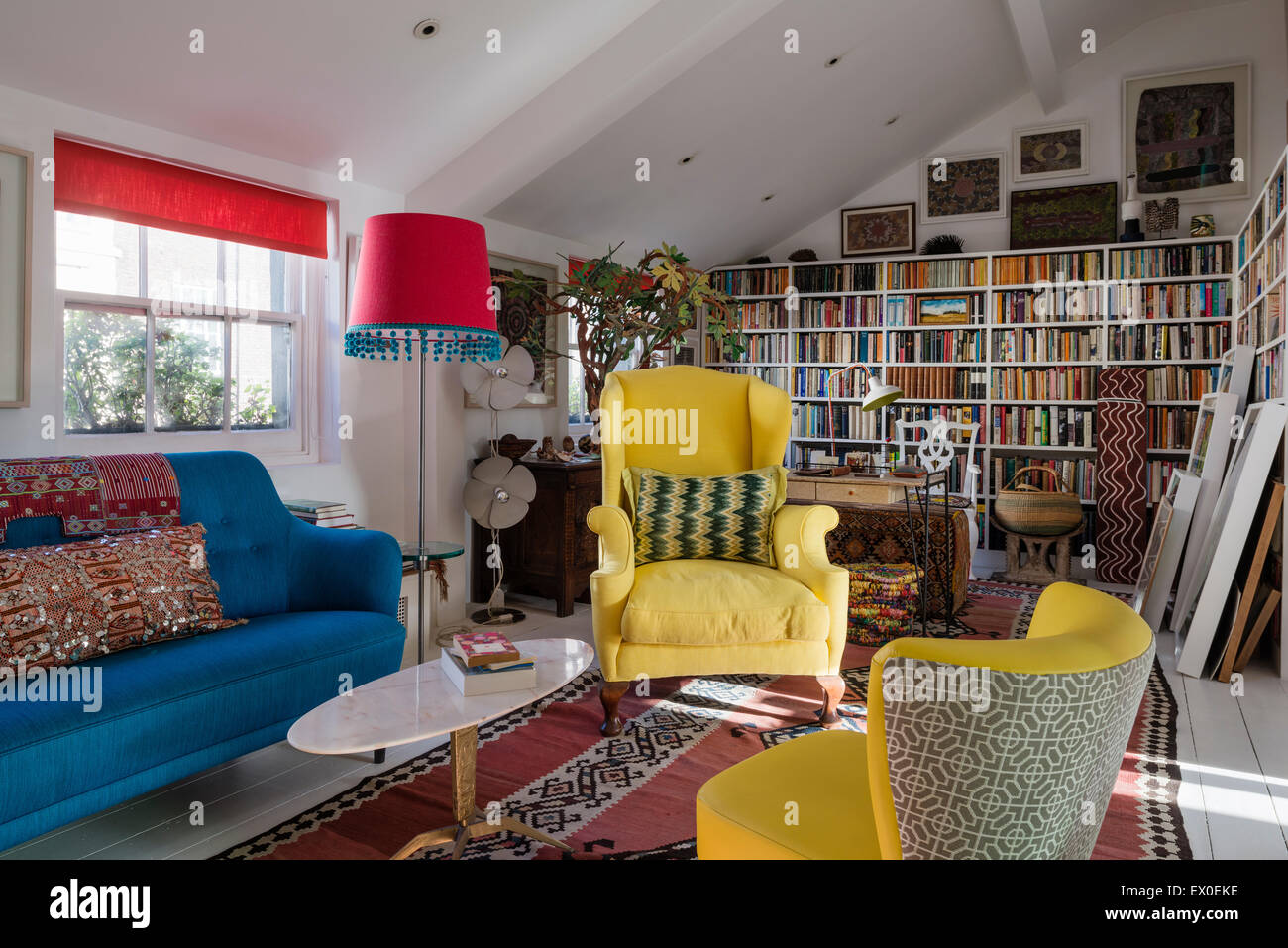Groovy Yellow Winged Back Armchair Julep Chair And Bold Blue Sofa Gmtry Best Dining Table And Chair Ideas Images Gmtryco