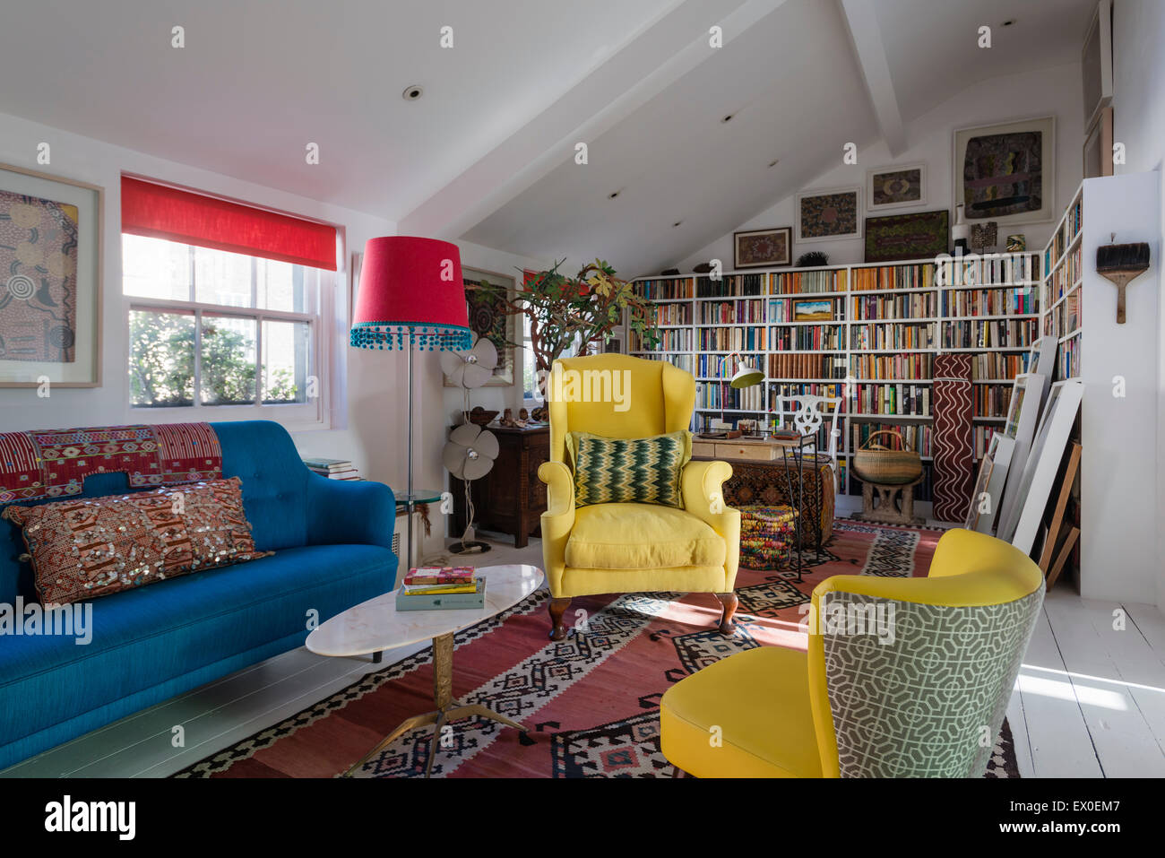 Yellow Winged Back Armchair, Julep Chair And Bold Blue Sofa In Living Room  With Uzbek Kilim, Aboriginal Art And Inbuilt Book She