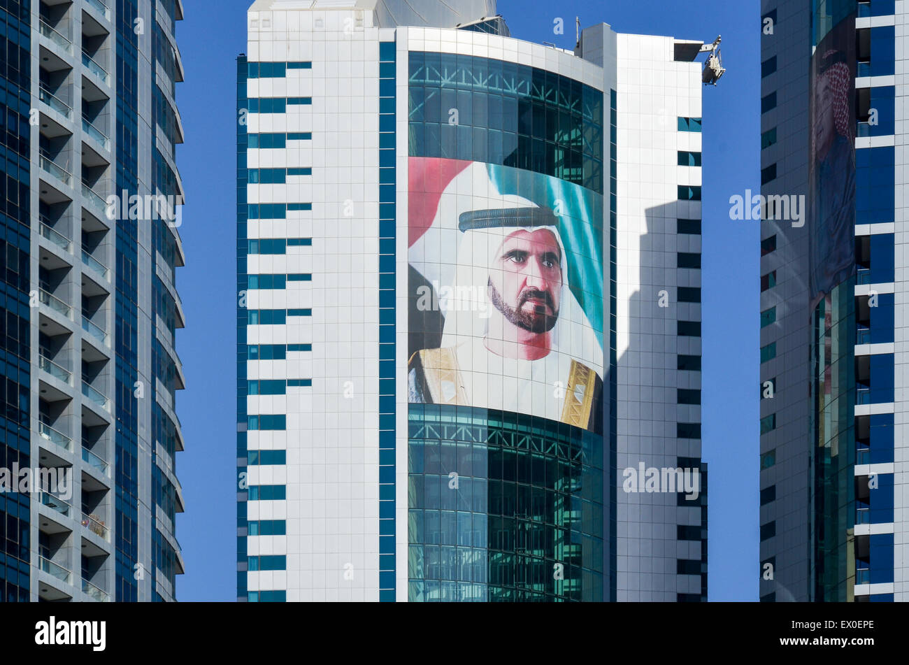 Portrait of Mohammed bin Rashid Al Maktoum on the towers of Dubai Marina - Stock Image