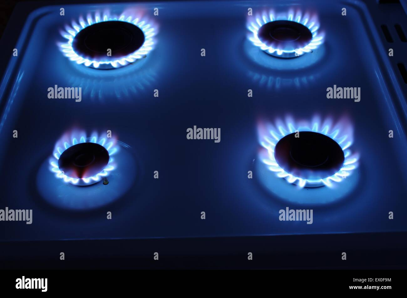 gas cooker with blue fire - Stock Image