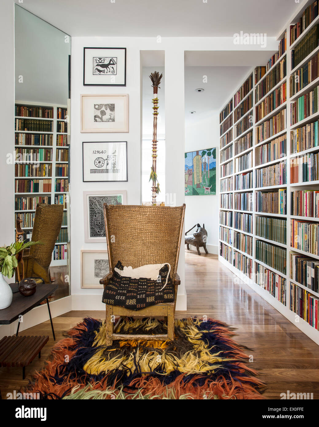 Antique Orkney chair in room with book shelving, shaggy rug and framed art. - Antique Orkney Chair In Room With Book Shelving, Shaggy Rug And