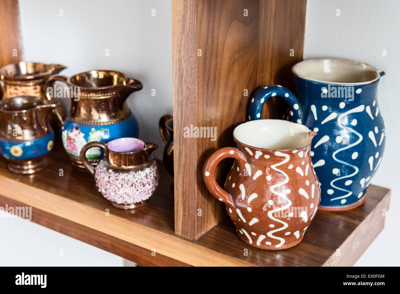 Earthenware jugs with a squiggle and dot glaze - Stock Image
