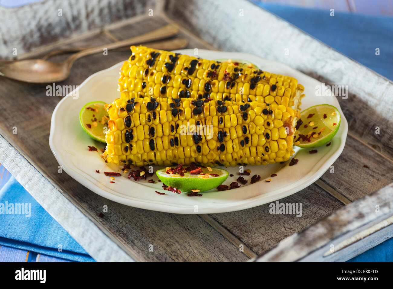 Grilled sweetcorn with lime and chilli flakes - Stock Image