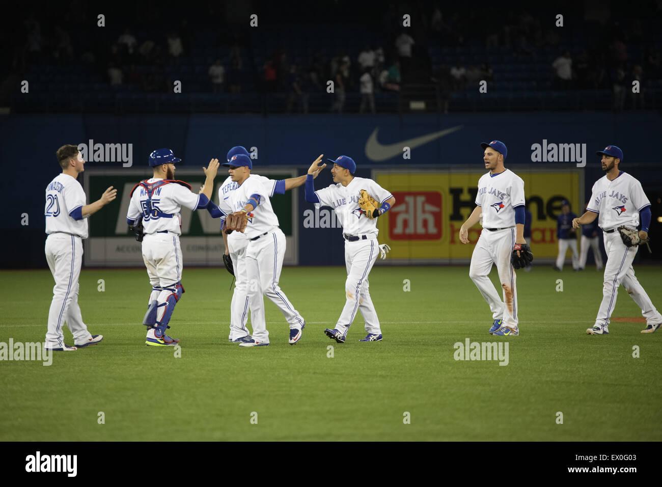baseball players celebrate win blue jays - Stock Image