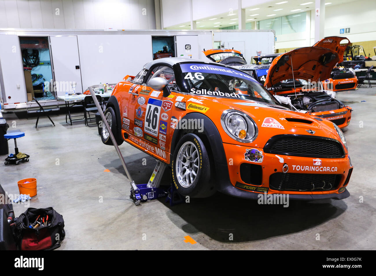 Mini cooper race car jacked up for repair Stock Photo: 84835287 - Alamy