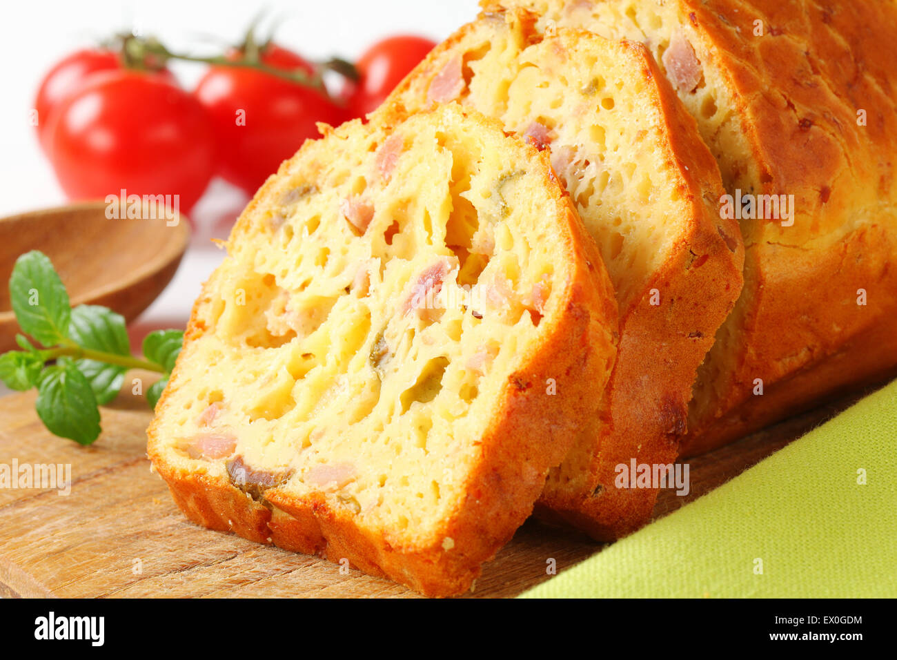 Slices of savory ham and olive cake - Stock Image