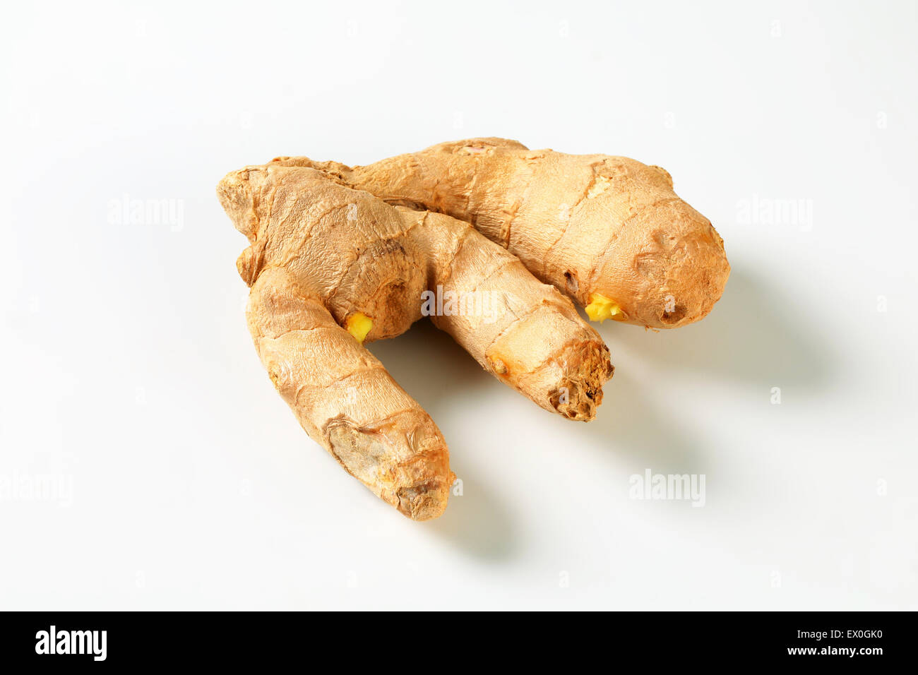 Fresh ginger root on white background - Stock Image
