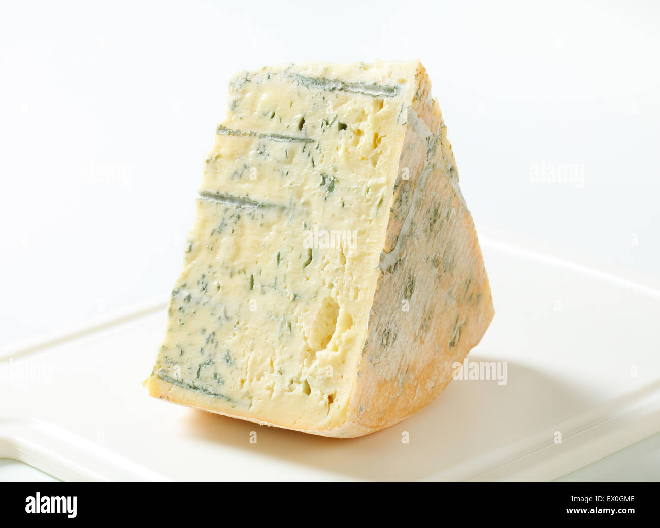 Blue cheese on a cutting board - Stock Image
