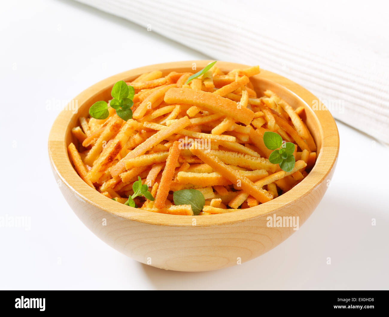 Pancake strips in a wooden bowl - Stock Image