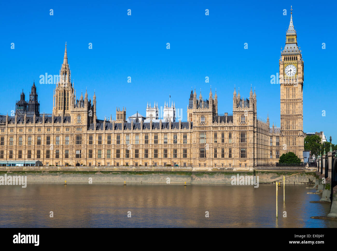 A view of the magnificent Palace of Westminster over the River Thames in London.  The towers of Westminster Abbey - Stock Image