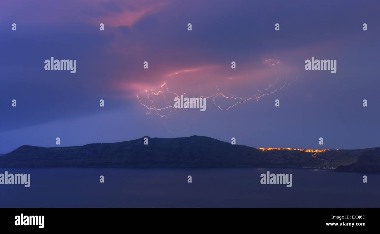 Lightning above Thirasia, one the Santorini islands on Cyclades islands in the Aegean Sea, Greece. - Stock Image