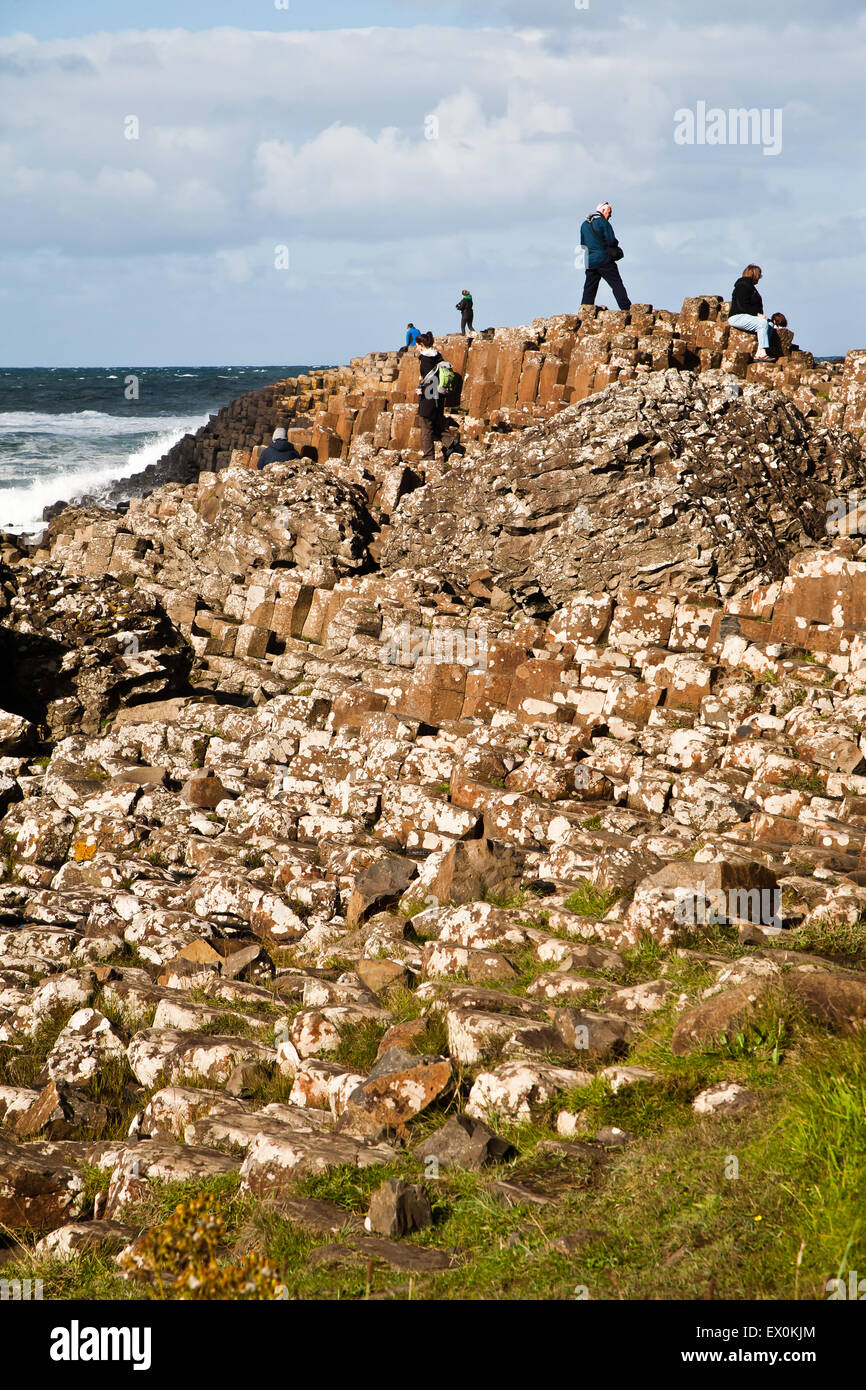 People on rocks at Giant's Causeway, Northern Ireland. - Stock Image