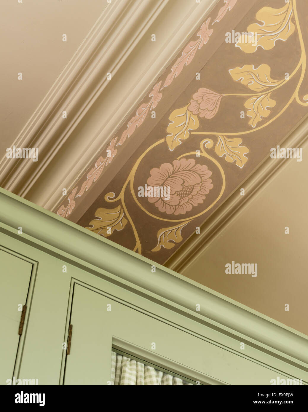 Detail of ceiling painting above cupboard - Stock Image