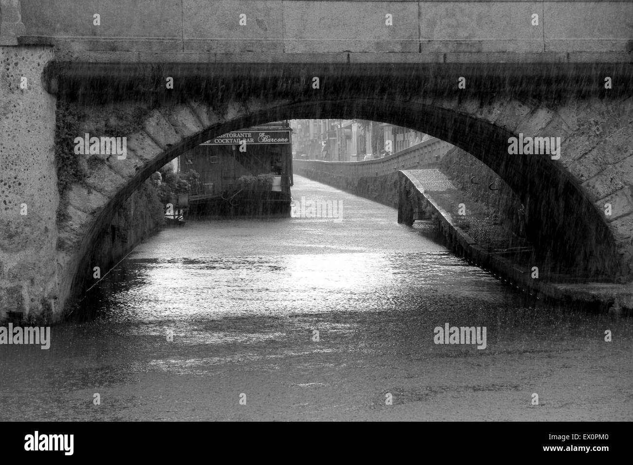 Bridge over the Naviglio canal in Milan, Italy - Stock Image