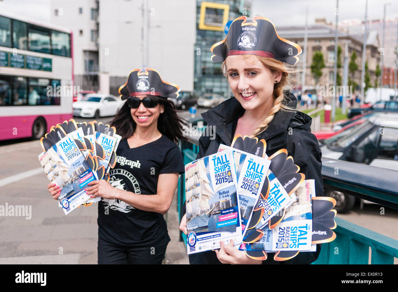 Belfast, Northern Ireland, UK. 03rd July, 2015. Two ladies sell Tall Ships programmes Credit:  Stephen Barnes/Alamy - Stock Image