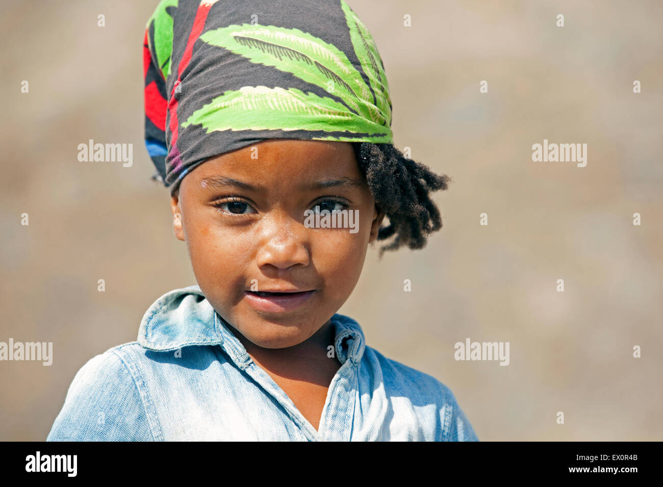 Close up portrait of Creole girl wearing headscarf on the island of Santiago, Cape Verde / Cabo Verde, Western Africa - Stock Image