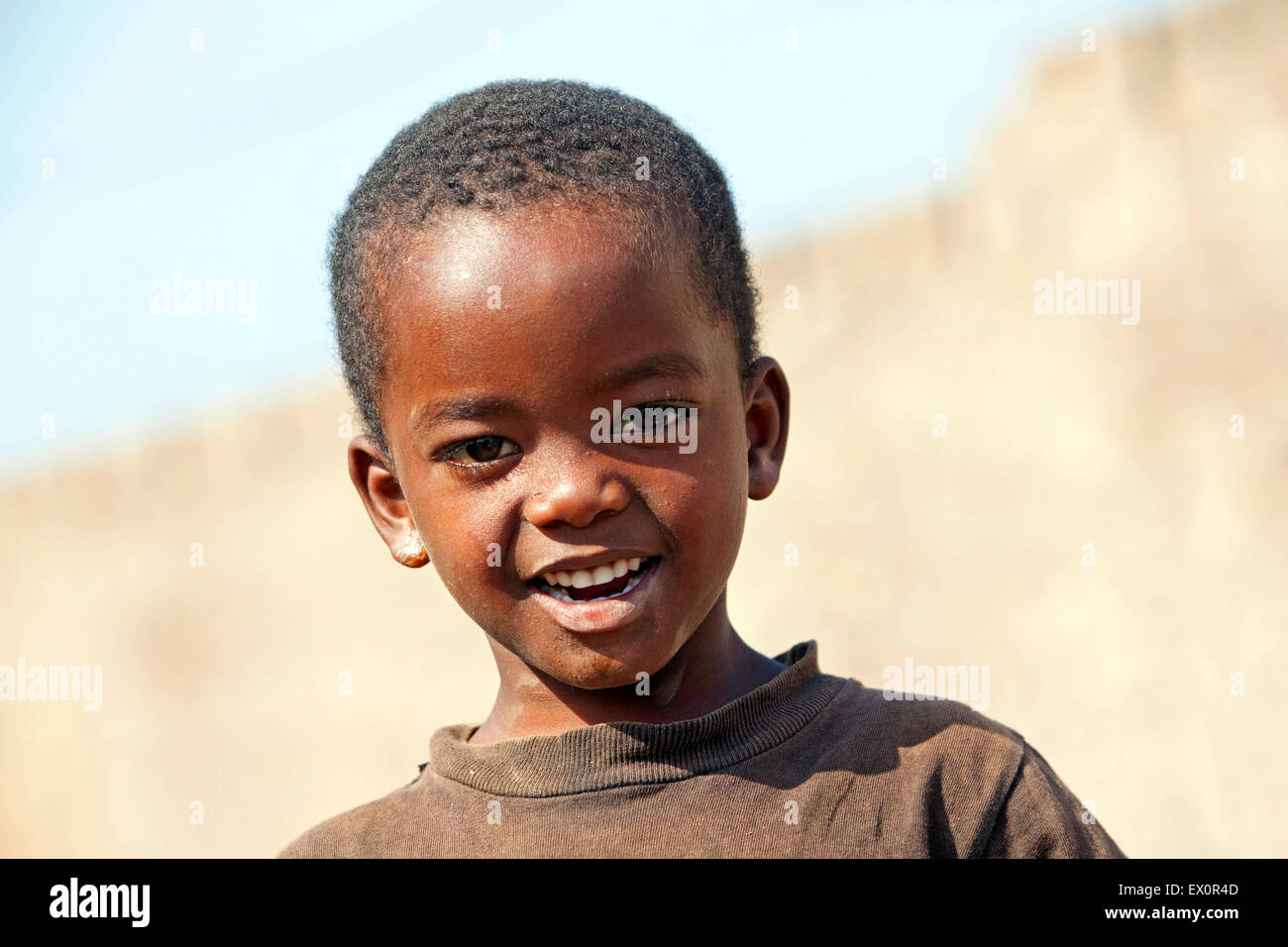 Close up portrait of Creole boy on the island of Santiago, Cape Verde / Cabo Verde, Western Africa - Stock Image