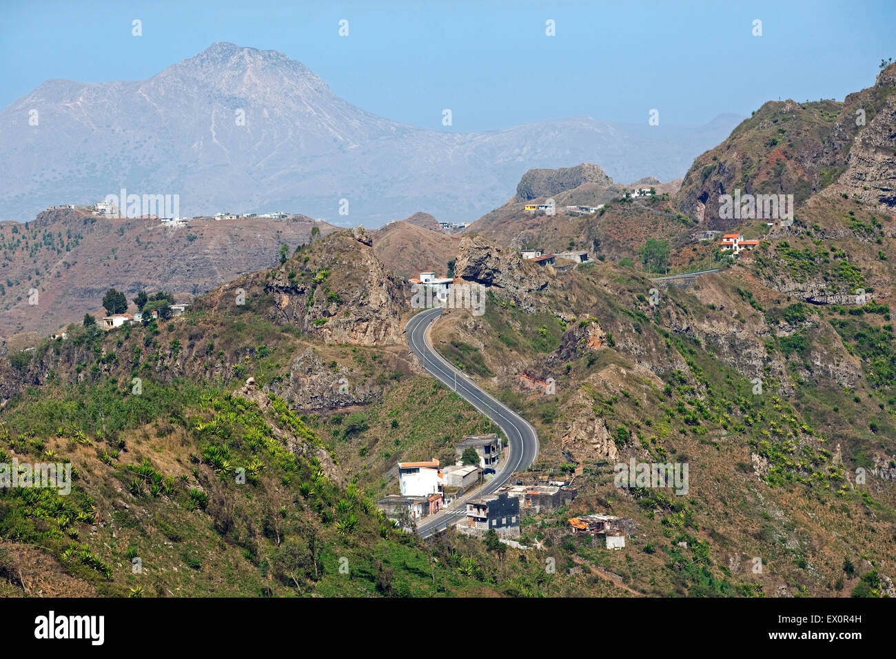 Houses along winding road through volcanic mountains in the interior of the island of Santiago, Cape Verde / Cabo - Stock Image