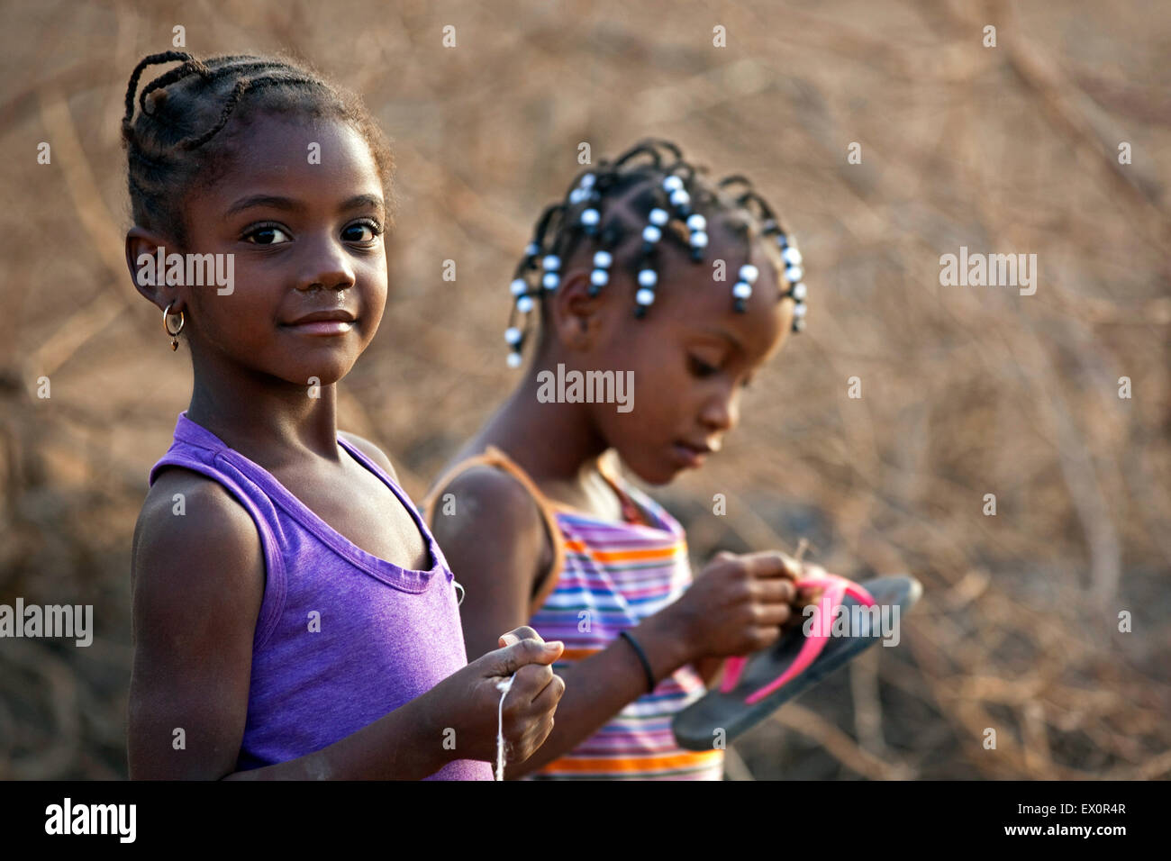 Portrait of two Creole girls with traditionally braided hair in the village Rebelados on the island Santiago, Cape - Stock Image
