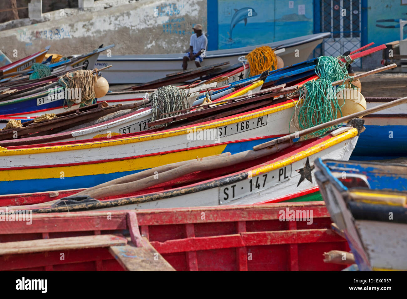 Colourful traditional wooden fishing boats in the harbour of Tarrafal on the island Santiago, Cape Verde / Cabo Stock Photo