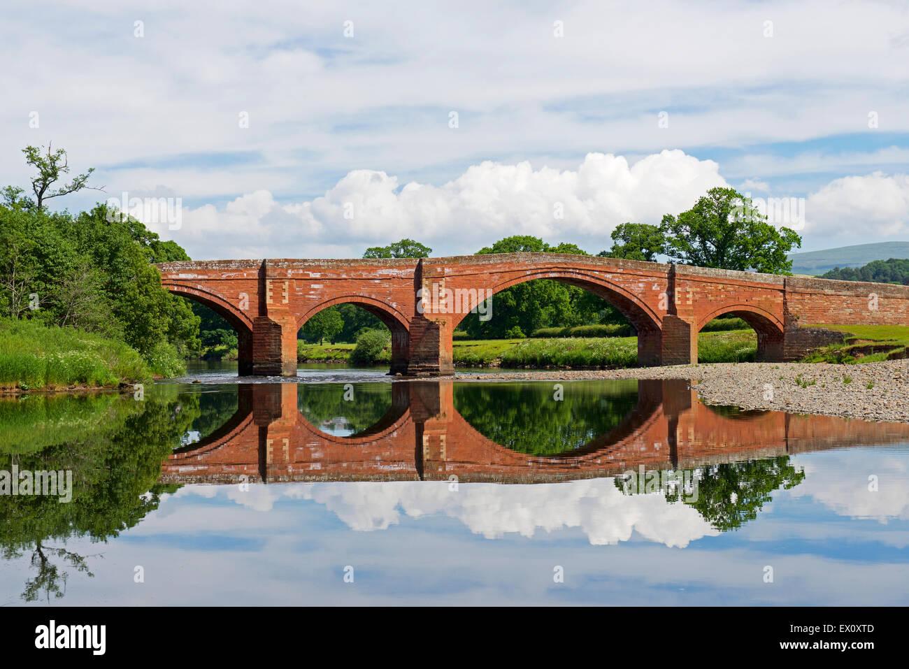 Sandstone bridge over the River Eden near Lazonby, Eden Valley, Cumbria, England UK - Stock Image