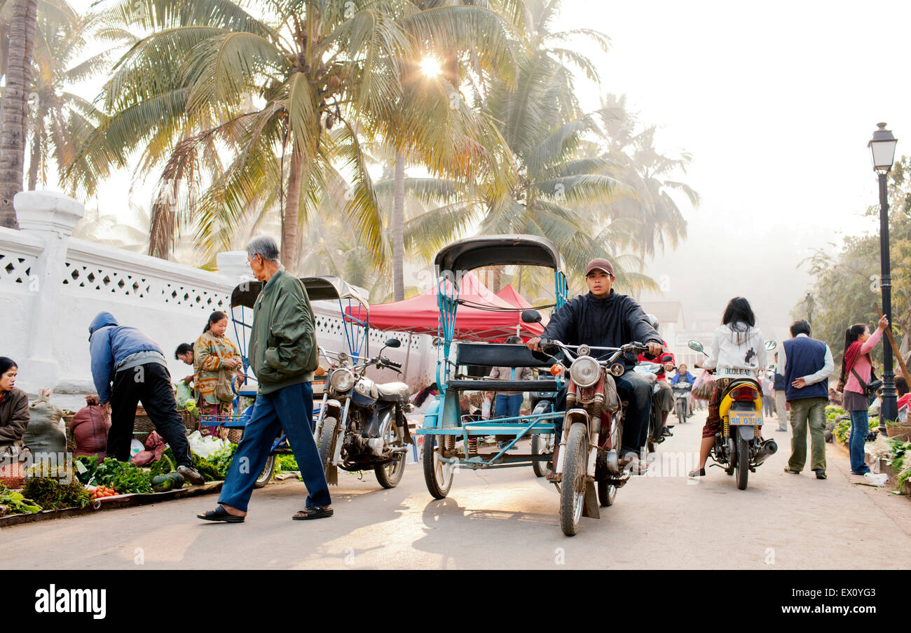 Laos Luang Prabang South East Asia Matthew Wakem Soldier Transportation Motocycle People Food and Drink Built Structure - Stock Image