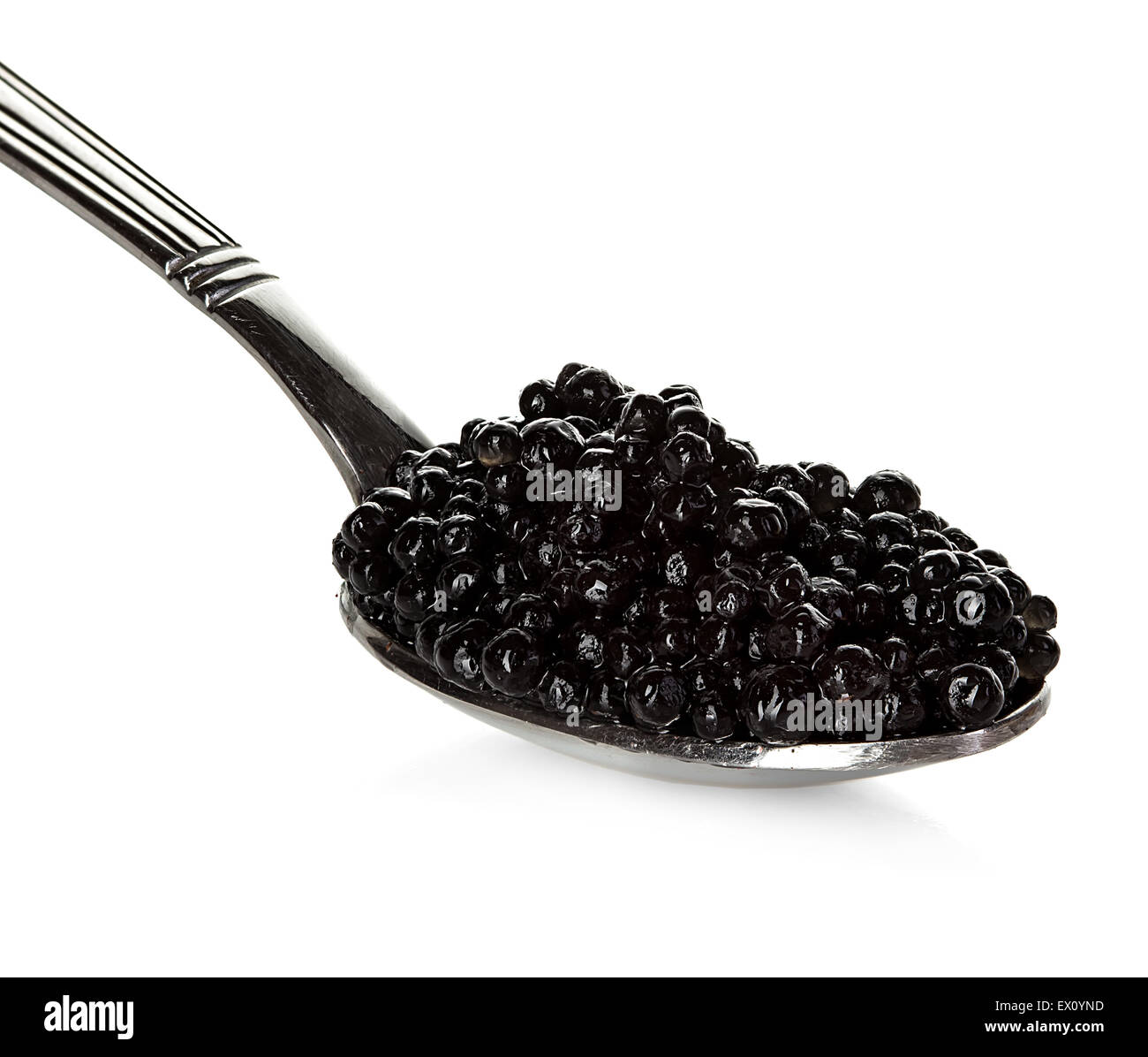 Black caviar in a spoon isolated on white background - Stock Image