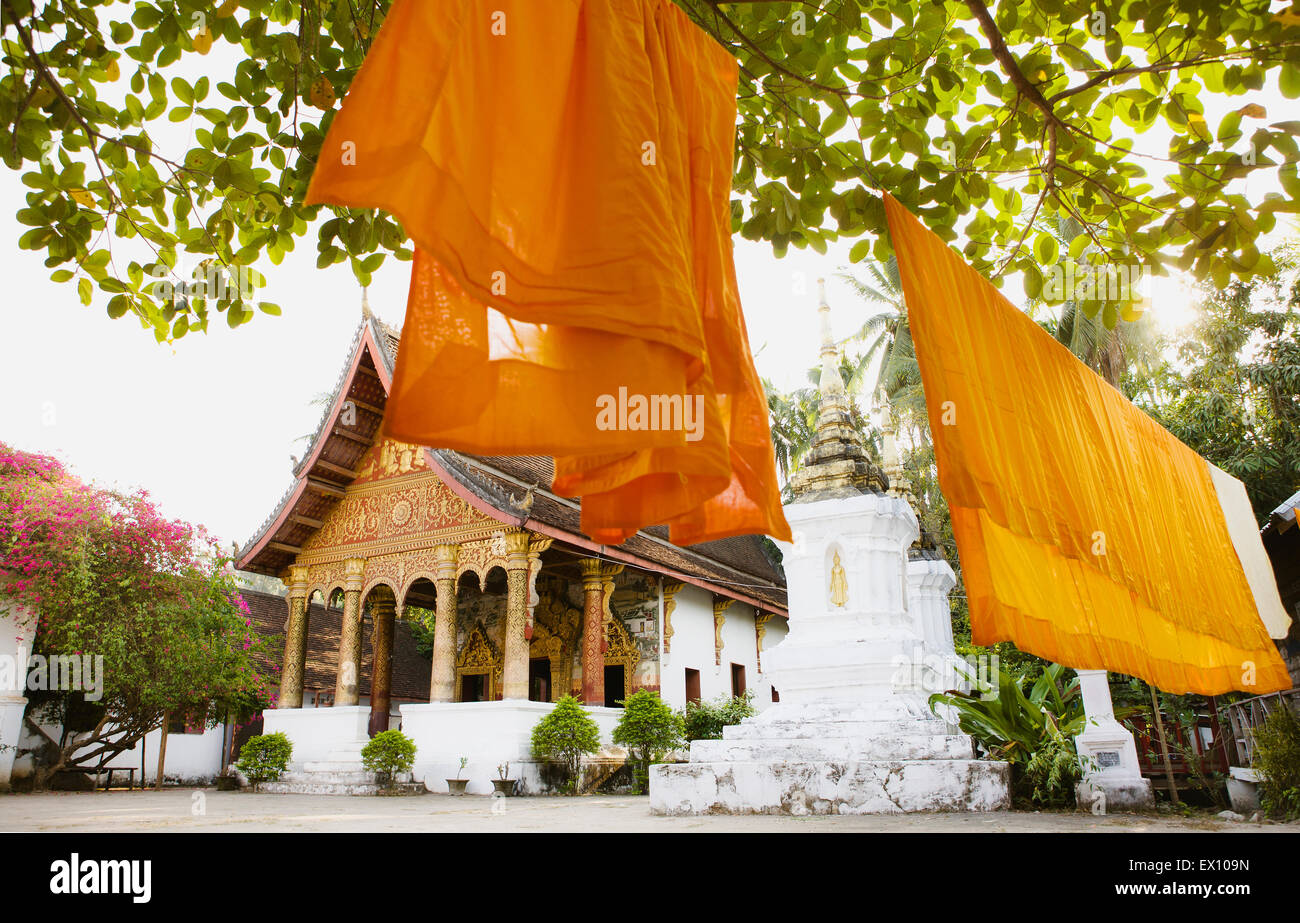 Saffron robes hanging in the courtyard of Vat Paphaimisaiyanaram. (This is the same as Wat Pa Pai.) Luang Prabang, - Stock Image