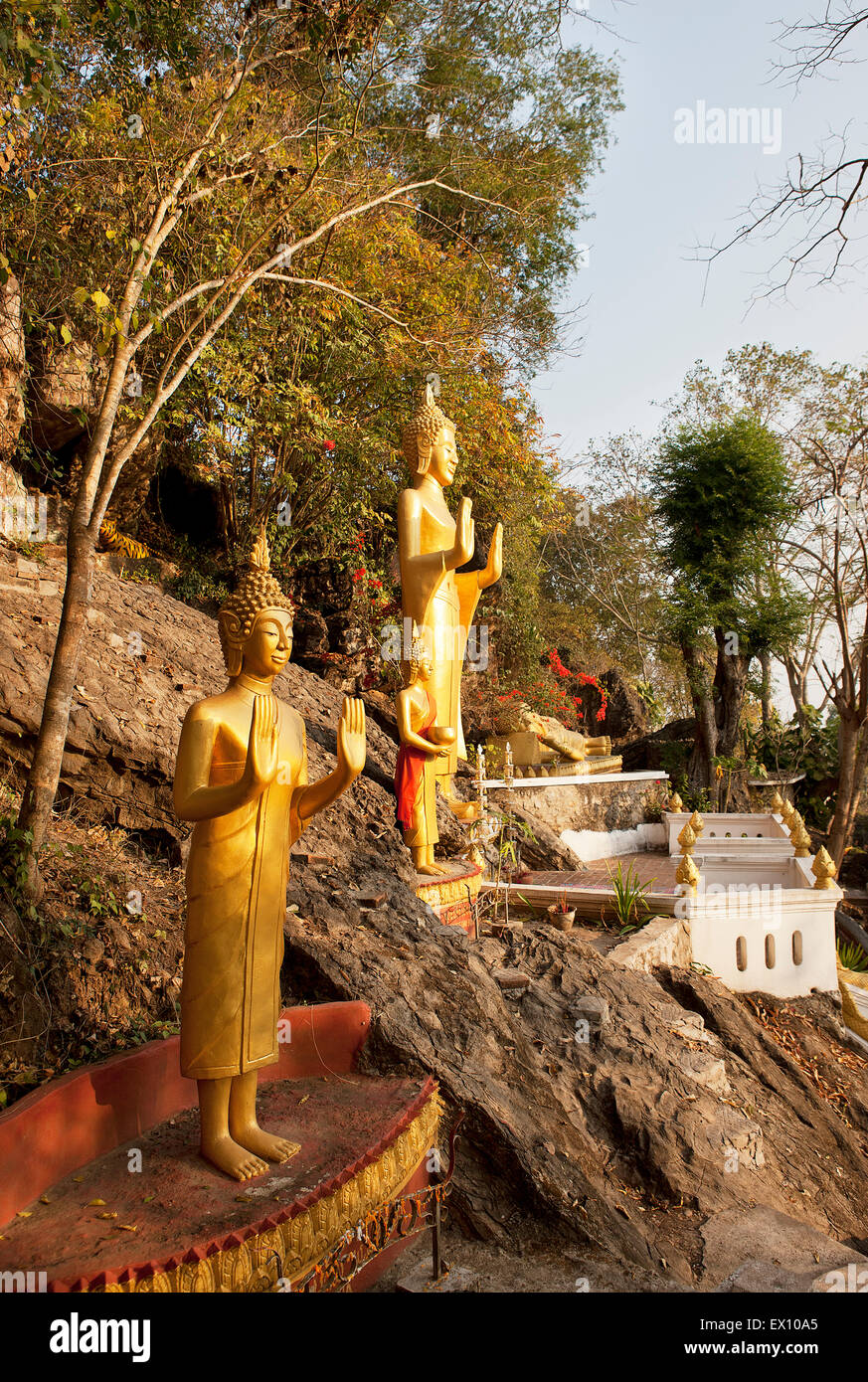 These golden statues on the Ban Khamyong side of Mt. Phou Si. depict the 7 positions of Buddha. - Stock Image
