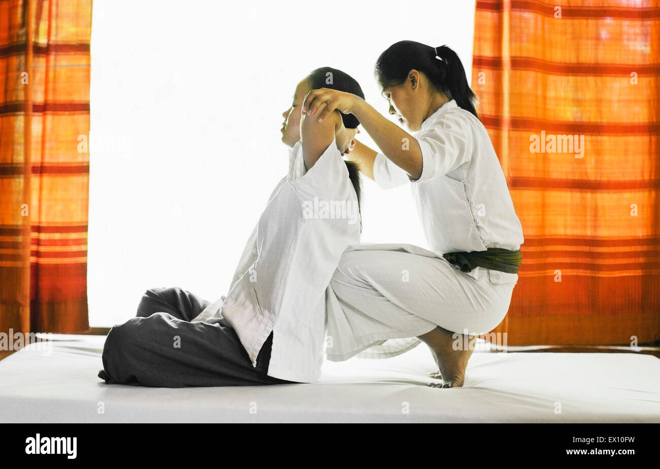 Sip Sen, or traditional Lao Massage at The Spa at La Residence Phou Vao, Luang Prabang, Laos. - Stock Image
