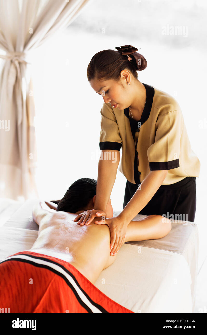 Woman receiving Aroma Thai Massage in spa treatment tents. Angsana Spa at Maison Souvannaphoum. Luang Prabang, Laos. Stock Photo