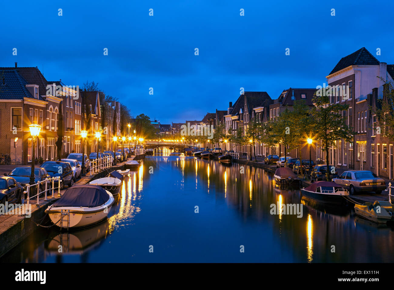 Houses, boats canal, Leiden, Holland, The Netherlands - Stock Image