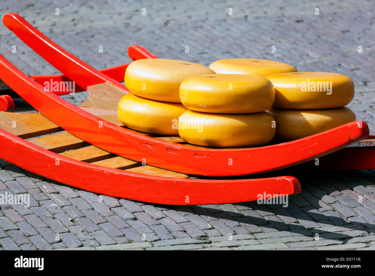 Cheese rounds on sled, Alkmaar Cheese Market, Holland, The Netherlands - Stock Image