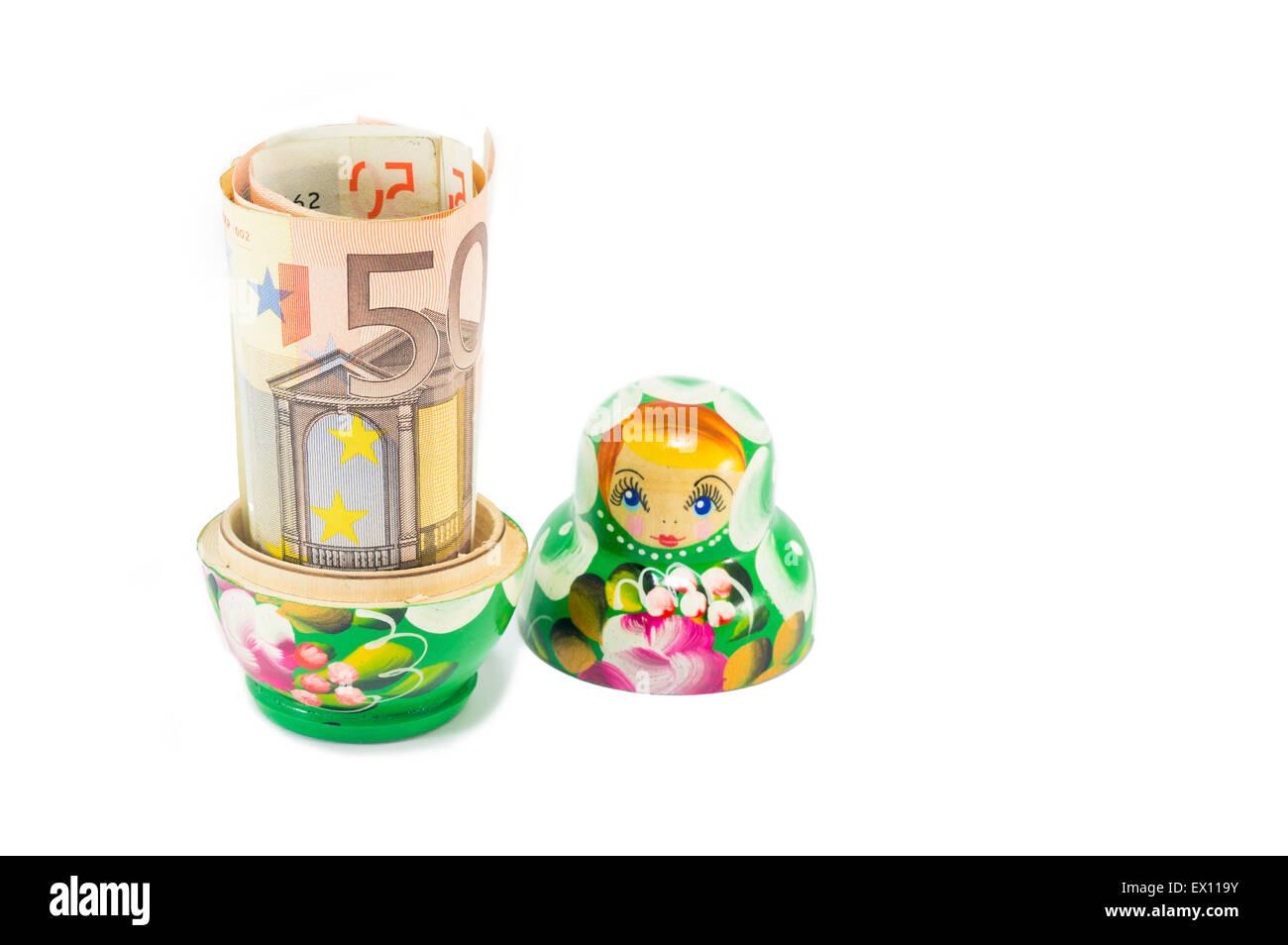 Russian Babushka Doll With 50 Euro Bill Isolated Stock Photo