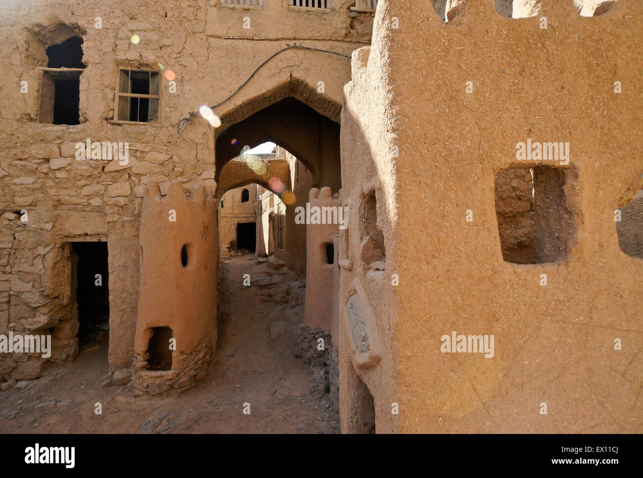 Ruins of mudbrick buildings in old section of Al-Hamra, Oman - Stock Image
