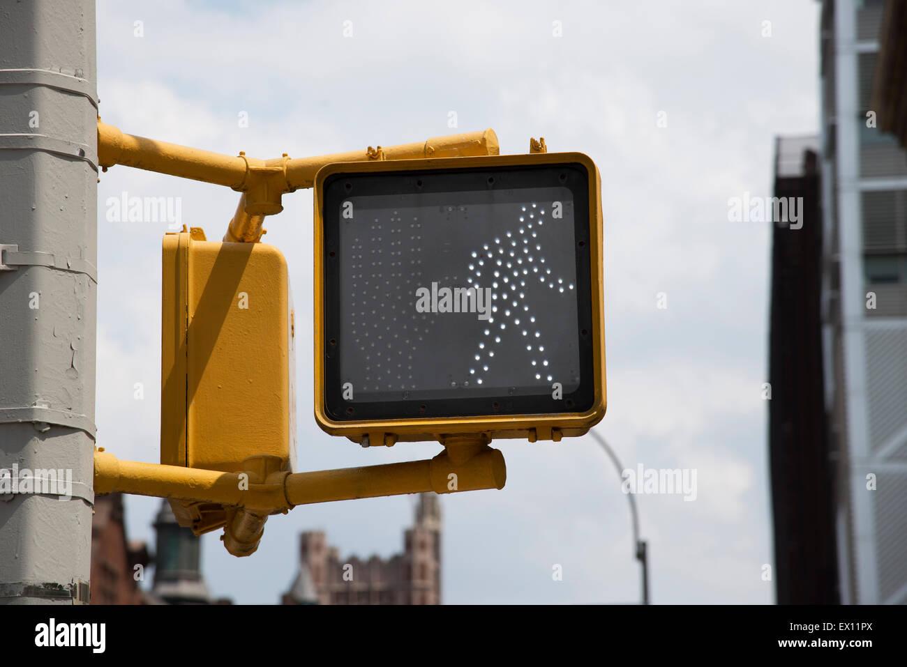 Pedestrian crossing 'walking man' sign in New York USA - Stock Image