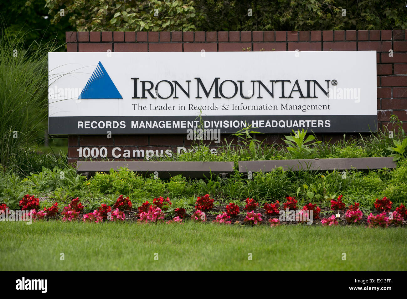 A logo sign outside the headquarters of the Iron Mountain Records Management Division in Collegeville, Pennsylvania. - Stock Image