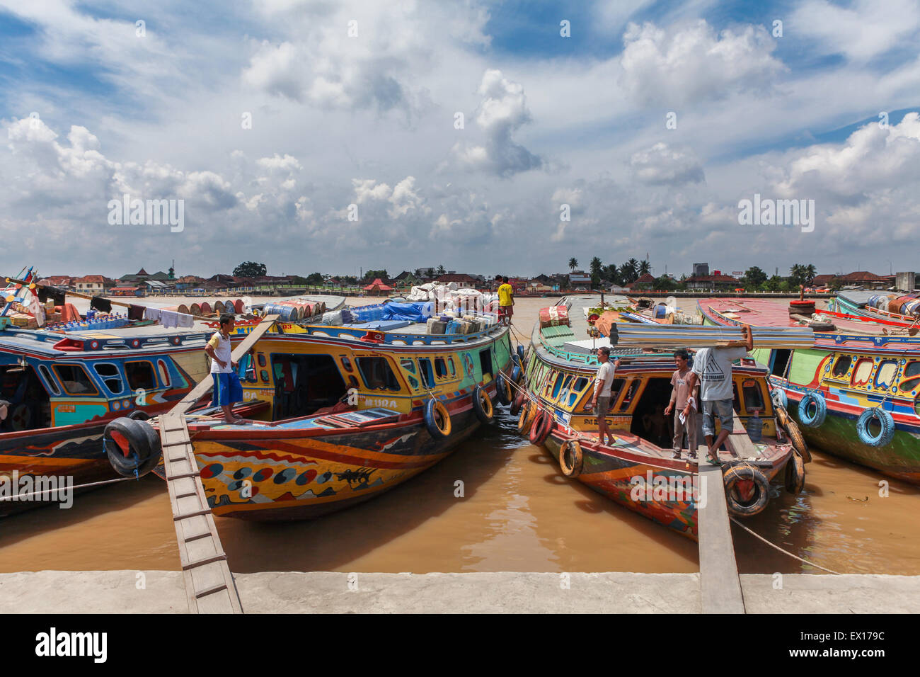 Wooden cargo and passenger boats on Musi River, Sumatra, Indonesia. © Reynold Sumayku - Stock Image