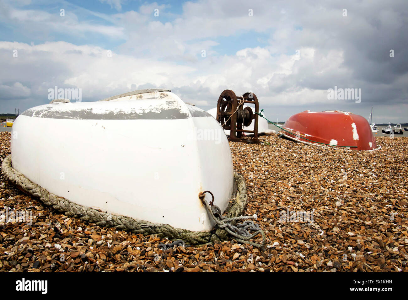 Upturned row boats on the foreshore - Stock Image
