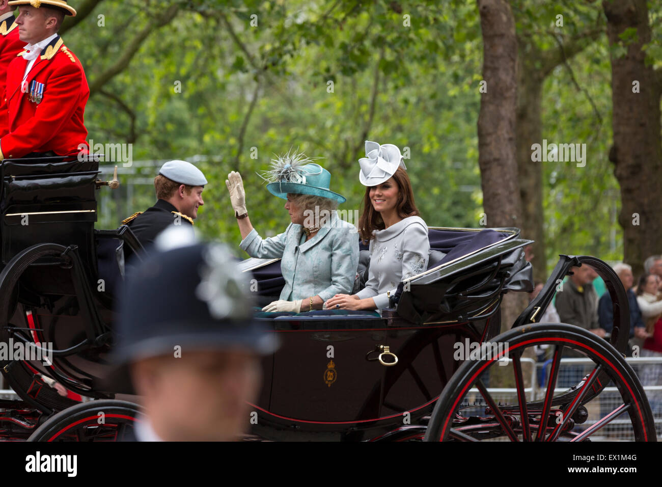 Kate Middleton, Camilla Parker Bowles, & Prince Harry in a carriage en route to the Trooping the Colour ceremony - Stock Image
