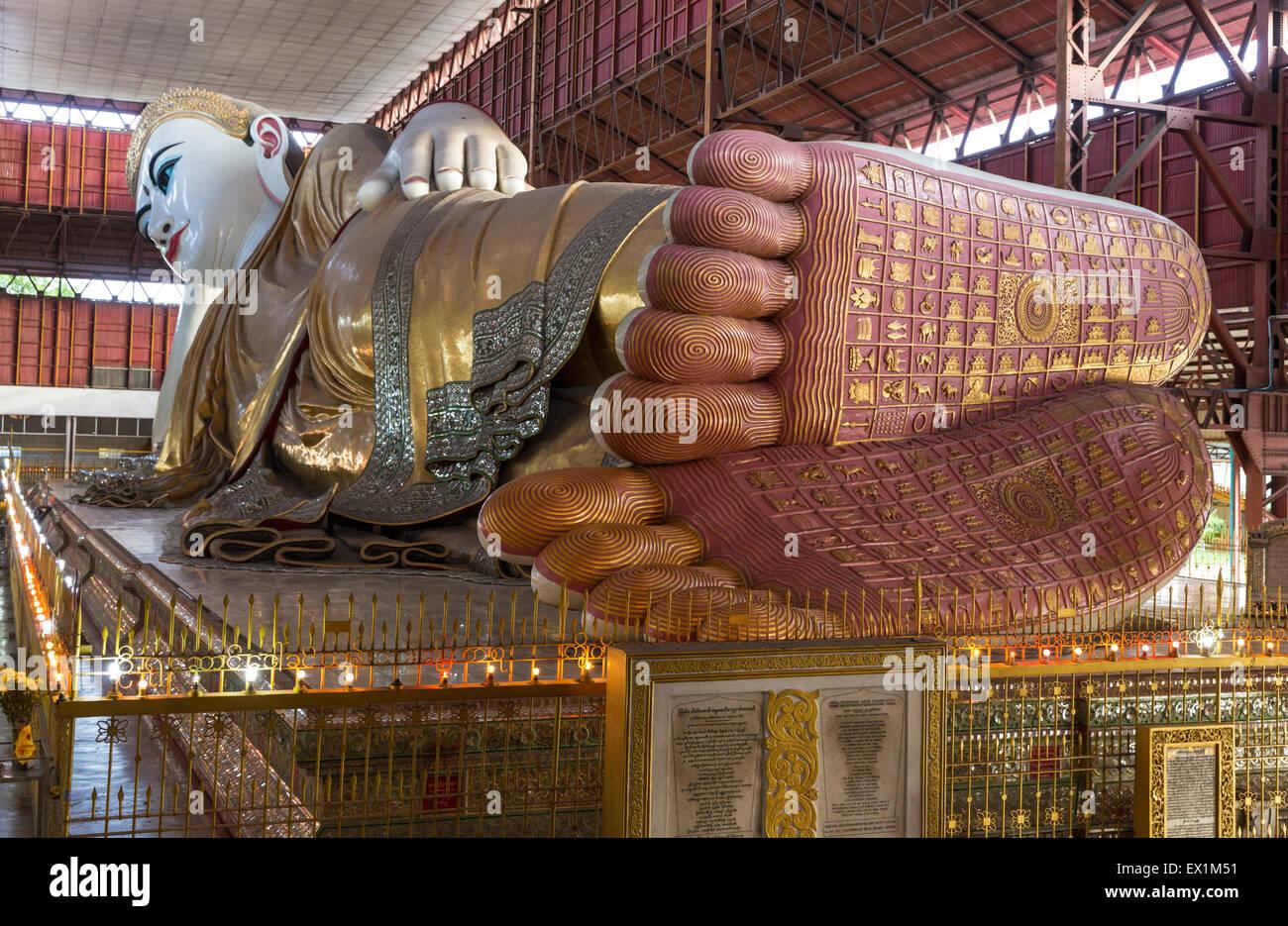 Colossal reclining buddha at Chaukhtagyi pagoda in Yangon, Myanmar - Stock Image