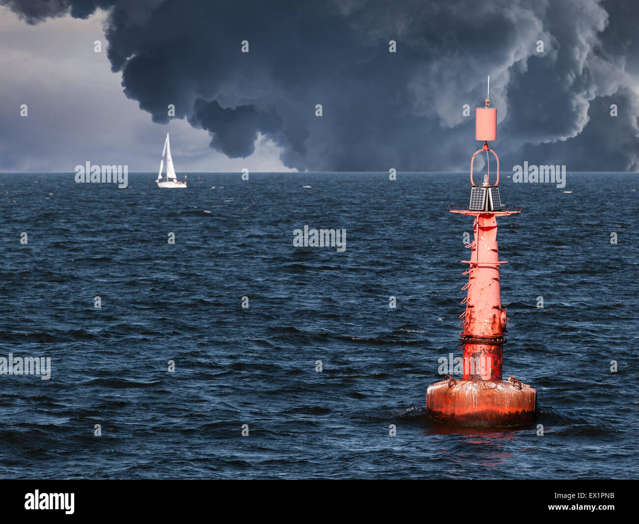 Red buoy on water in a stormy day. - Stock Image