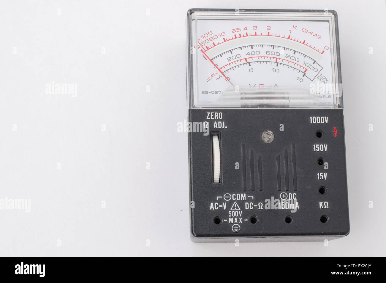Black Volt Meter on White Background - Stock Image