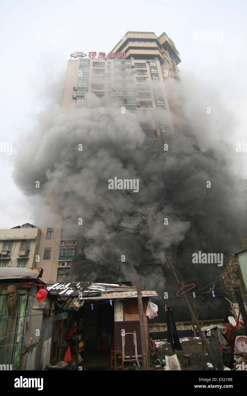 A fire is seen on  a commercial building in Wuhan, Hubei province January 8, 2010. The reasons are under investigation. - Stock Image