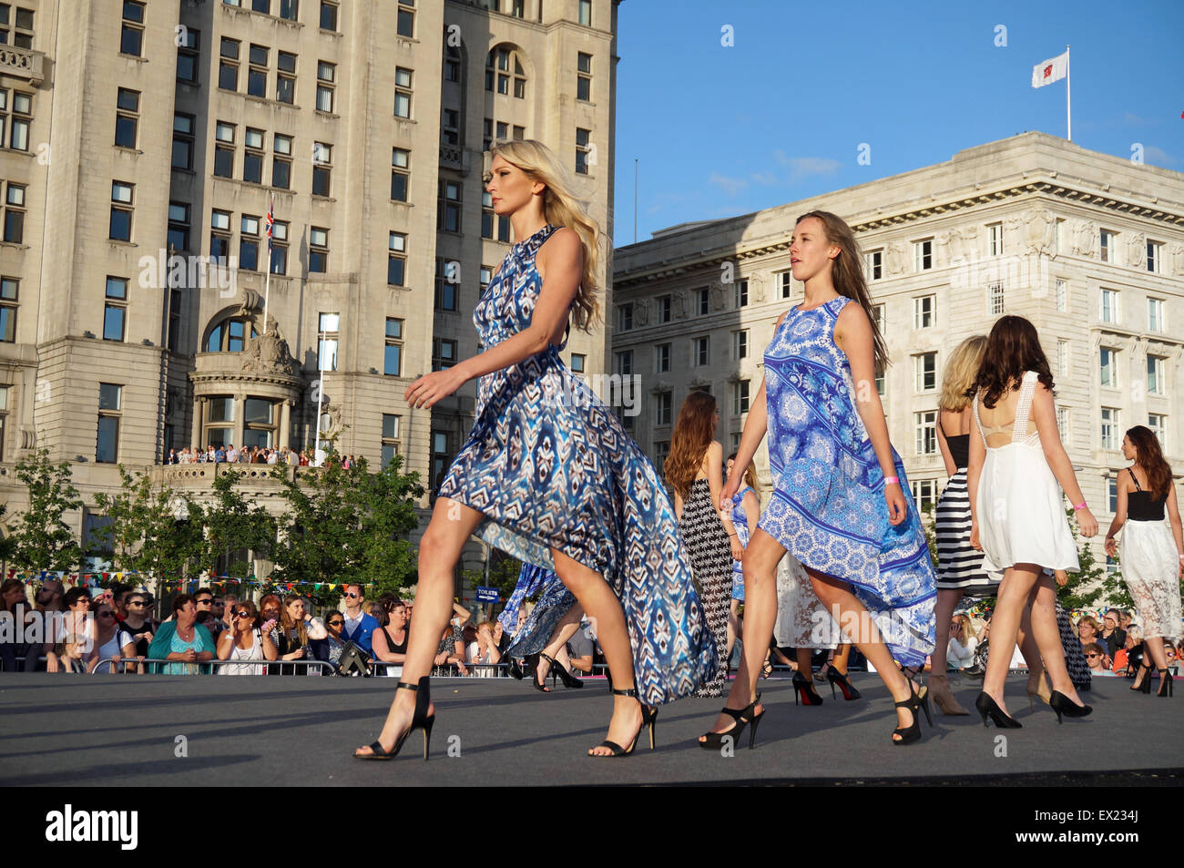 Liverpool, UK. 04th July, 2015. A new Guiness World Record for most people modelling on a catwalk was broken in - Stock Image