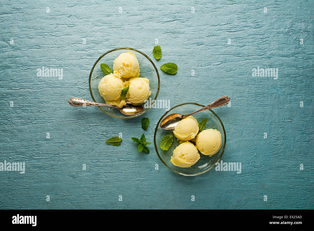Fresh fruit sorbet ice cream in a glass plate - overhead shots. - Stock Image