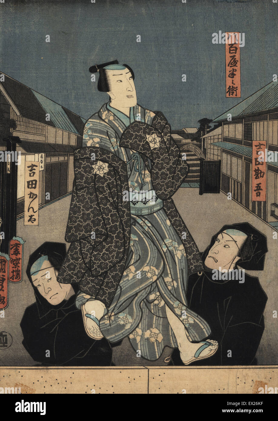 Puppet in kimono being manipulated by two bunraku puppeteers in black robes. Woodblock ukiyo-e print by Utagawa - Stock Image