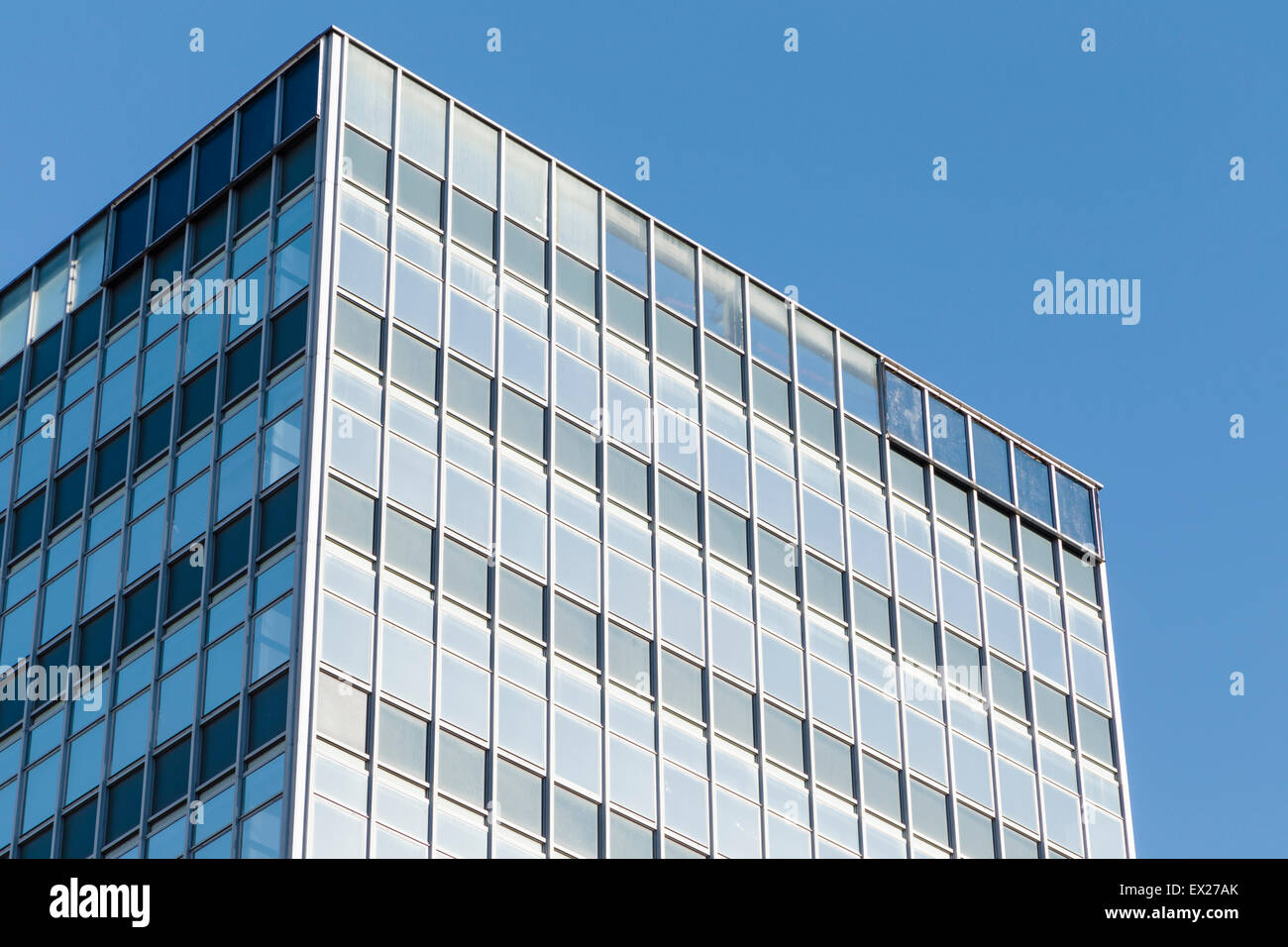A generic modern office block in Manchester against a blue sky. - Stock Image