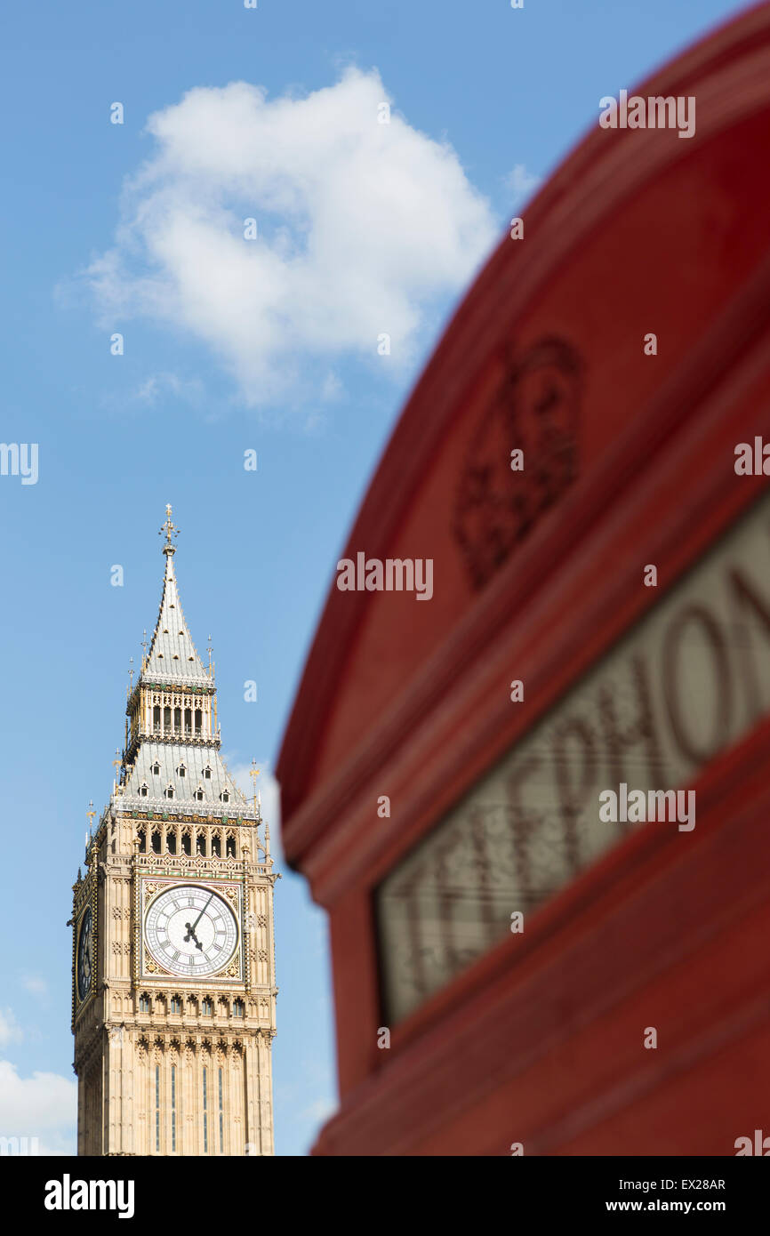 UK, London, Red telephone box and Big Ben clock tower from Parliament  square. - Stock Image